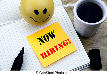 Writing text showing Now Hiring. Business concept for Hire Recruitment written sticky note empty paper, Wooden background with copy space, Coffee and marker