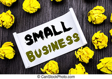 Writing text showing Small Business. Business concept for Family Owned Company Written on sticky note notepad note notebook book wooden background with yellow sticky folded.