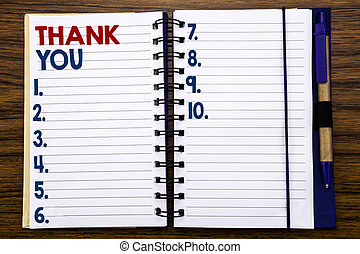 Writing text showing Thank You. Business concept for Gratitude Thanks Written on notebook note paper, wooden background with pen and marker.