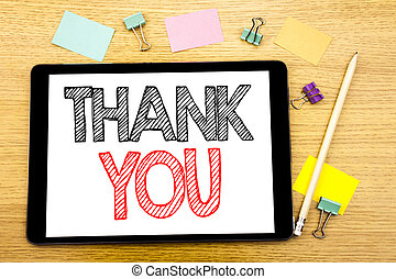 Writing text showing Thank You. Business concept for Gratitude Thanks Written on tablet laptop, wooden background with sticky note and pen