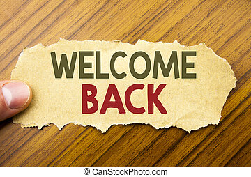 Writing text showing Welcome Back. Business concept for Emotion Greeting written on note paper on the wooden background with human finger. Vintage style.