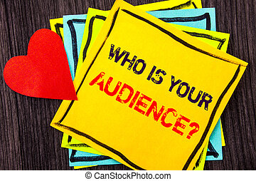 Writing text showing Who Is Your Audience Question. Concept meaning Customer Target Service Client Research written on Stikcy Note Paper on the wood background Love Heart