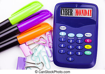 Writing word Cyber Monday text in the office with surroundings such as marker, pen writing on calculator. Business concept for Retail Shop Discount white background with copy space