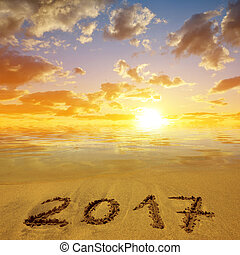 Written 2017 on the sandy beach at sunset. Concept of New...
