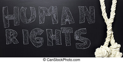 written human rights with rope on the blackboard.