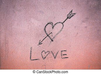 Written love sign with cinder on cement wall