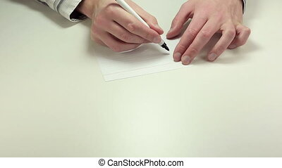 Written note USD - Man hands write the abbreviation USD on...