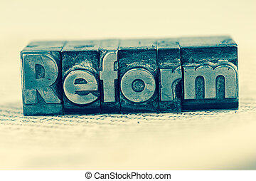 written reform in lead letters - the word reform in lead...
