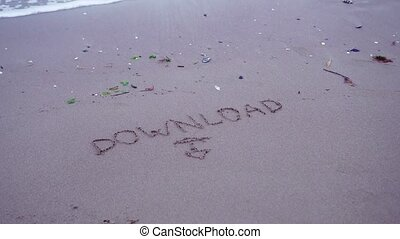 "Written ""Sownload"" on the sand of the beach"