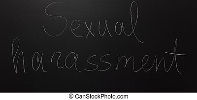 written text with on blackboard: Sexual harassment.