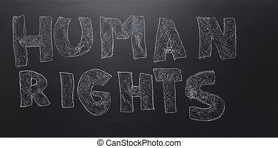 written the word - human rights on the blackboard.