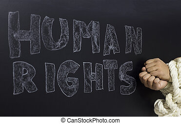 written the word human rights with knotted hand on the blackboard.