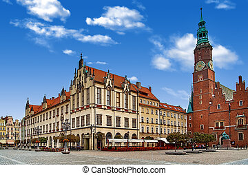 Wroclaw Market Square with Town Hall. Cloudy sky in historical capital of Silesia Poland, Europe. Travel vacation concept