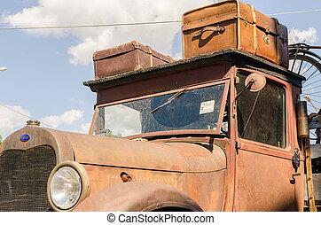 WROCLAW, POLAND - August 11, 2019: USA cars show - Old rusty Ford truck pickup 1930 - 1931-1939 with stylish vintage suitcases on the roof.