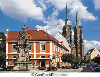 WROCLAW, POLAND - AUGUST 2013: Monument to John of Nepomuk and the Cathedral of St. John the Baptist on the island Tumskoe on august 05, 2013 in Wroclaw