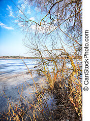 WROCLAW, POLAND - FEBRUARY 22, 2021: Frozen lake landscape. The Milicz Ponds (Polish: Stawy Milickie). Nature Reserve in Barycz Valley Landscape Park. Lower Silesian Voivodeship, Poland, Europe.