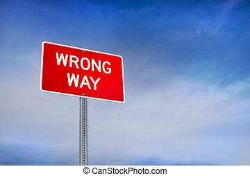 Wrong Way Road Sign and Blue Sky Behind