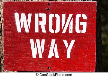 Wrong Way sign with the N facing the wrong way.