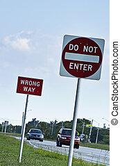 Wrong way street signs
