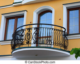 balcony door and wrought lattice on the background of the white plastered walls