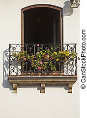 Wrought iron balcony with flowers