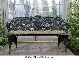 wrought iron bench in garden