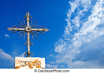 Wrought Iron Cross on Blue Sky