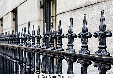 Wrought Iron Fence Along Limestone Building