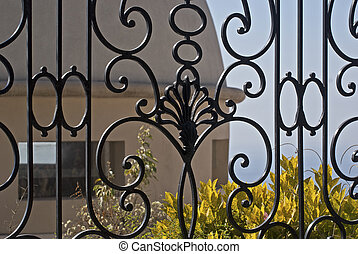 Wrought iron fence in foreground - Wrought iron fence with...