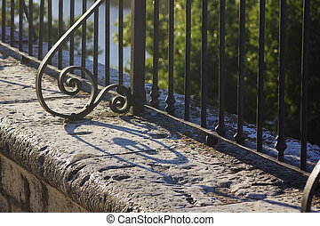 wrought iron fence with her ??elongated scraps