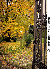 iron gate in the autumn park