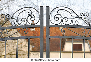 wrought iron gate - details of a wrought iron gate in front...