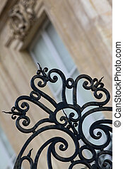 Wrought iron gate - Rusty wrought iron gate in front of a...