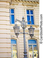 Wrought iron lanterns on a background window