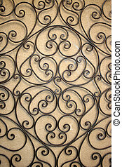 wrought iron - wroght iron gate on a yellow wall