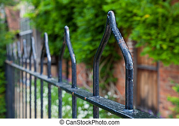 Wrought iron railings with weathered black paint