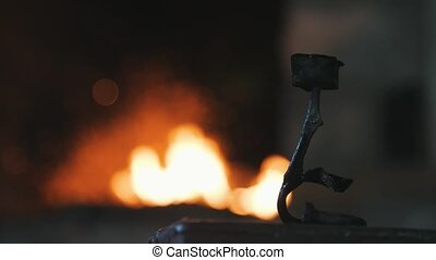 Wrought iron rose at a forge with flame in a blacksmith...