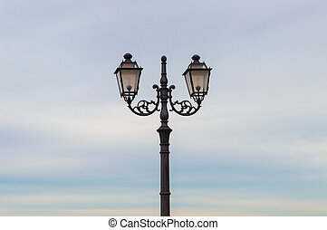 Wrought iron street lamp - An ornate street lamp with double...