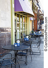Wrought Iron Tables on Small Town Sidewalk