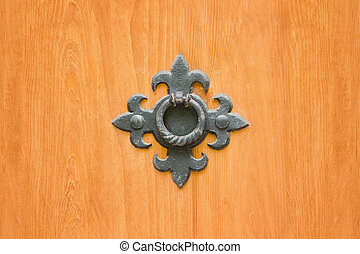 Wrought metal ring on a wooden door. Close up
