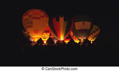 WS Balloon Glow2 - WS of hot air balloons bursting their...