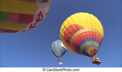 WS Hot Air Balloons low angle - WS of a string of hot air...