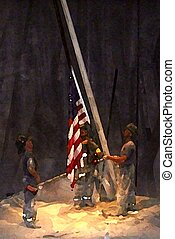 A shot taken at a wax museum of firemen putting up the flag after 9/11. The photo was edited to look like a painting.