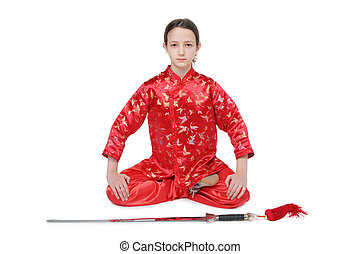 Wushu girl with sword sits