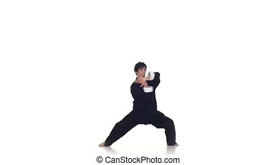 Wushu or karate man makes rack on a white, Slow motion -...
