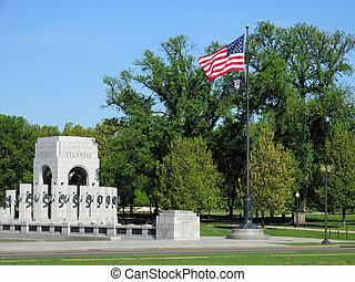 WW II memorial atlantic arch and american flag and POW flag