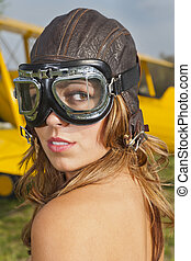 Brunette model posing with a WW1 aircraft