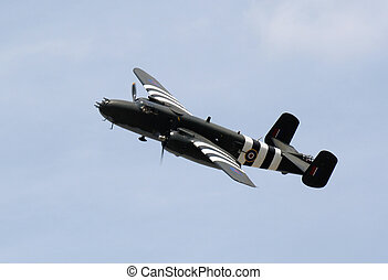 WWII Bomber - A WWII bomber soaring across the sky.