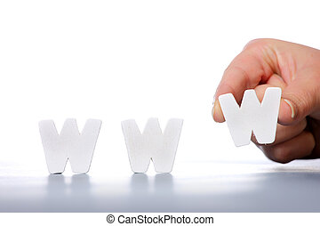WWW - A picture of female hand creating a word www over...