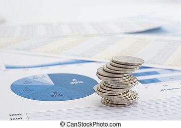 wykresy, monety, stóg